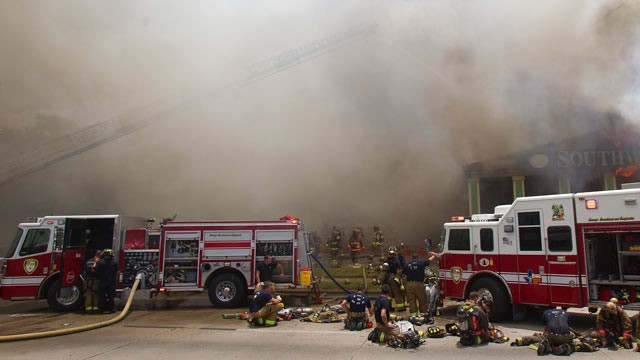 PHOTO: Firefighters battle a fire at the Southwest Inn, May 31, 2013, in Houston, Texas.