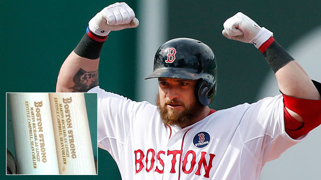 PHOTO: Boston Red Sox's Jonny Gomes used specially designed bats in tribute to the victims of the Boston Marathon bombings, in Boston, April 20, 2013.