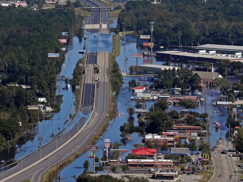 PHOTO: Floodwaters from Hurricane Matthew covers Interstate 95 and homes and businesses in Lumberton, North Carolina, Oct. 12, 2016.