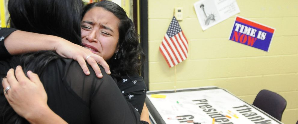 PHOTO: Laura Moreno, of Nampa, hugs her good friend Krista Busmante after watching President Obamas speech on immigration reform, Nov. 20, 2014 at the Hispanic Cultural Center in Nampa, Idaho.