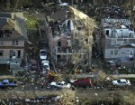 PHOTO: Houses are damaged along Iowa Avenue east of downtown Iowa City, Iowa, April 14, 2006, after a tornado hit the city. A recent study explains how people get on with their lives after such a harrowing experience.