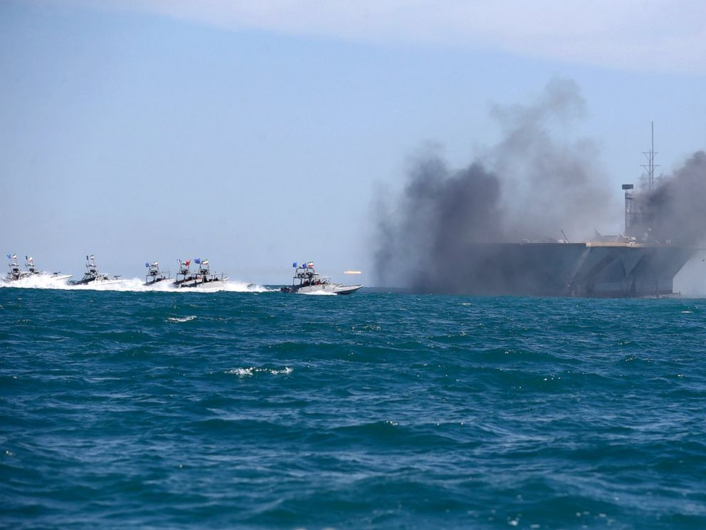 PHOTO: In this picture released by the Iranian Fars news agency, on Feb. 25, 2015, Revolutionary Guard speedboats assault a replica of a U.S. aircraft carrier during large-scale naval drills near the entrance of the Persian Gulf, Iran.