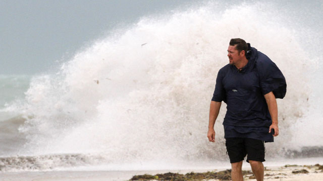 PHOTO: A man walks on the beach in Key West, Fla., Sunday, Aug. 26, 2012 as heavy winds hit the northern coast from Tropical Storm Isaac.