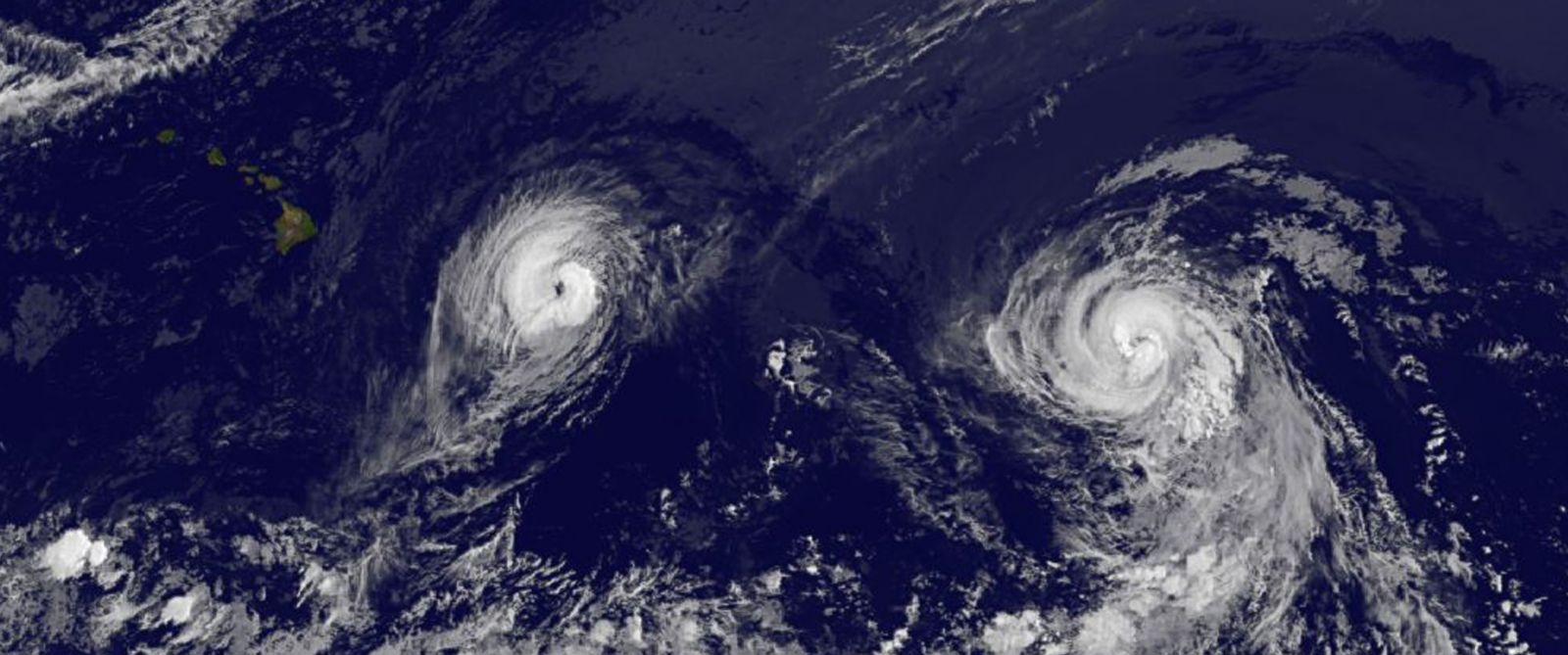 PHOTO: This image provided by NOAA taken Aug. 7, 2014 at 2 a.m. EDT shows Hurricane Iselle, left and Hurricane Julio.