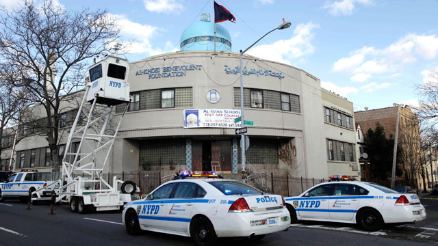 PHOTO: Police raise an overhead surveillance lift in front of the Iman al-Khoei Benevolent Foundation in New York, Jan. 2, 2012. The foundation houses an Islamic cultural center, including a school, that was attacked with a Molotov cocktail at the front o