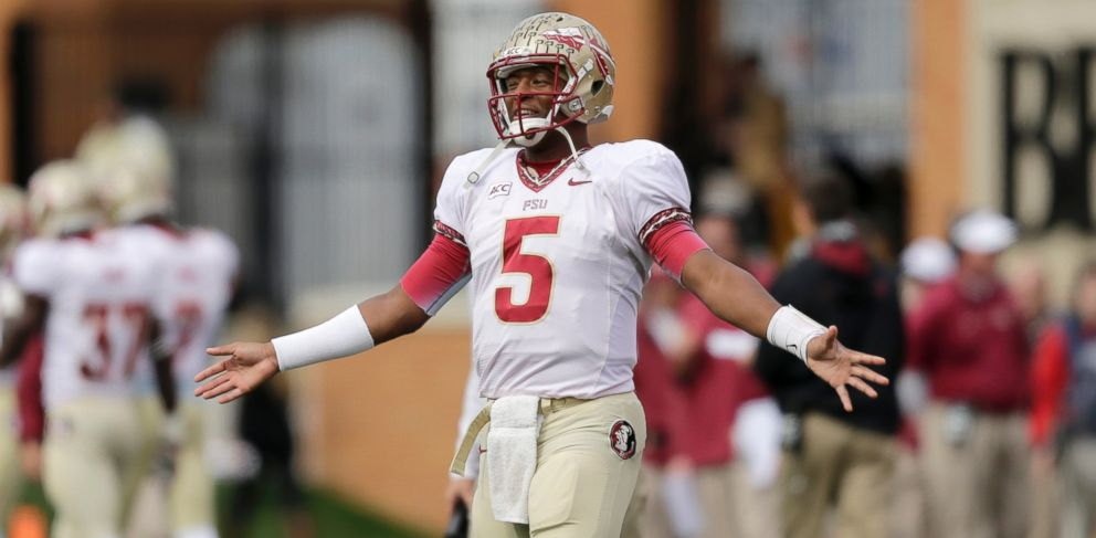 PHOTO: Florida State quarterback Jameis Winston watches on the sidelines as his team plays Wake Forest in the first half