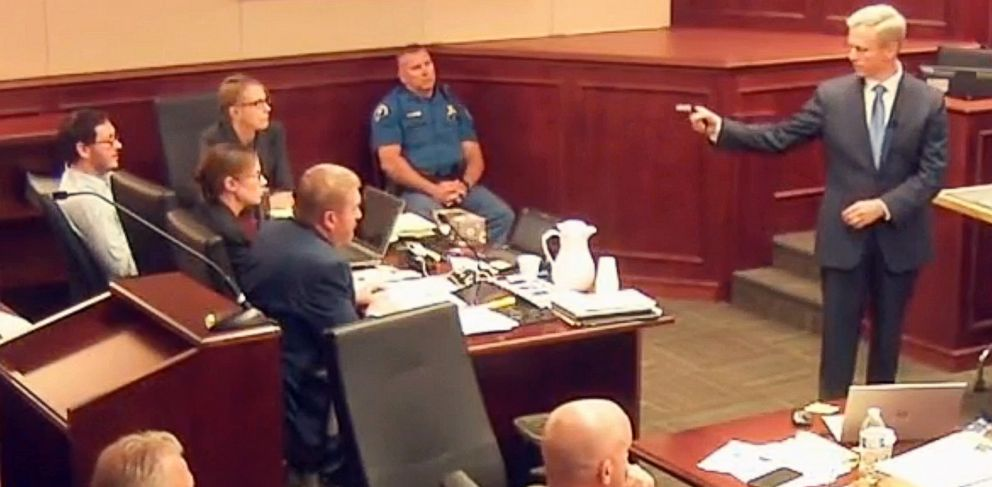 PHOTO: In this image taken from video, accused Colorado theater shooter James Holmes, background left, listens to lead prosecutor George Brauchler give closing arguments during his trial, in Centennial, Colo., July 14, 2015.