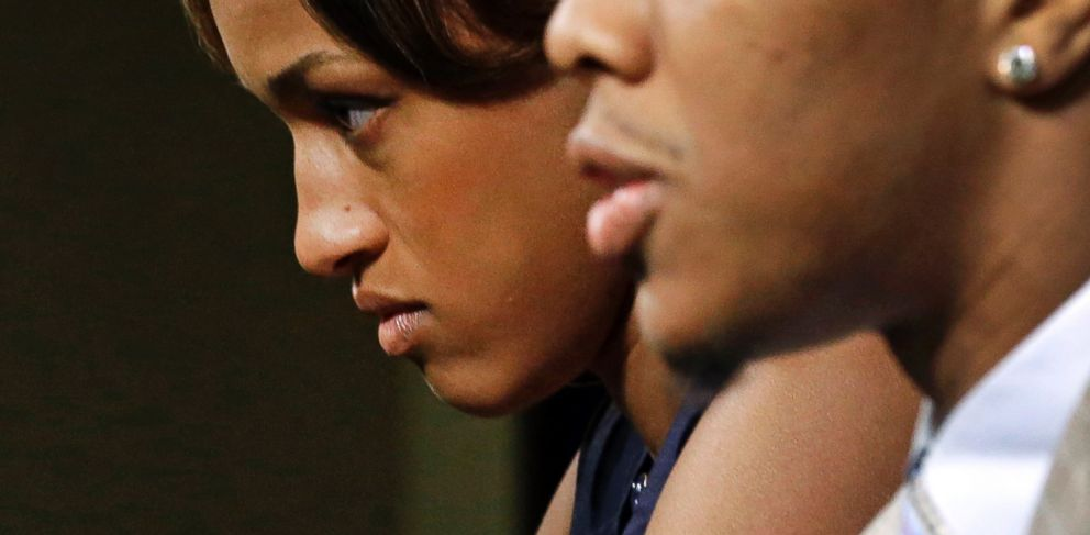 PHOTO: Janay Rice looks on as her husband, Ray Rice, speaks to the media during a news conference in Owings Mills, Md. on May 23, 2014.