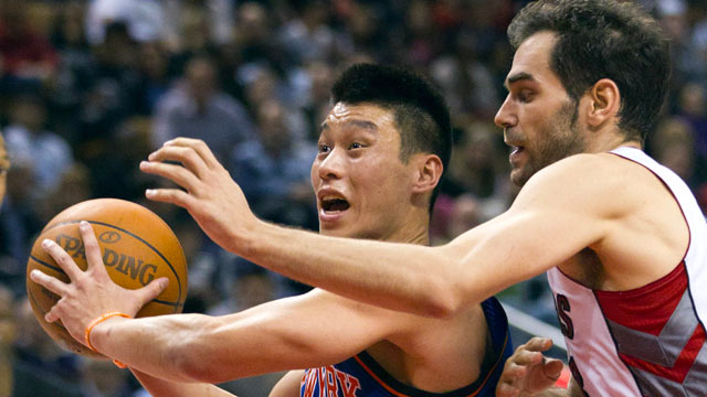 PHOTO: New York Knicks guard Jeremy Lin drives past Toronto Raptors guard Jose Calderon during the second half of an NBA basketball game in Toronto, Feb. 14, 2012.