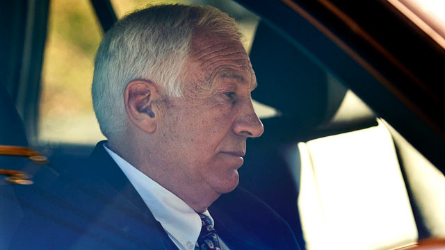 "PHOTO: Gerald ""Jerry"" Sandusky sits in a car as he leaves the office of Cent"