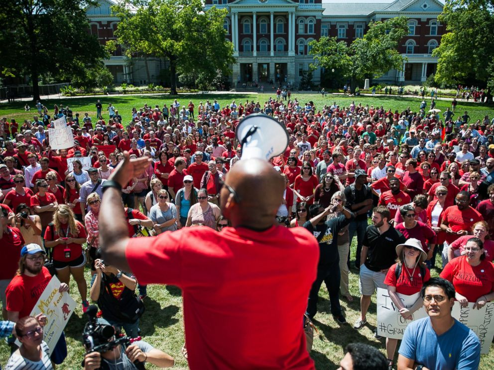 PHOTO: Jonathan Butler encourages a crowd to scream while using a megaphone during a day of action to celebrate graduate students and draw attention to demands on Aug. 26, 2015, near the columns on the University of Missouri campus, in Columbia, Mo.