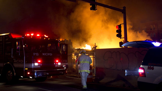 PHOTO: Firefighters on the scene of a gas explosion and massive fire Tuesday night, Feb. 19, 2013 at JJs restaurant at the Country Club Plaza in Kansas City, Mo.