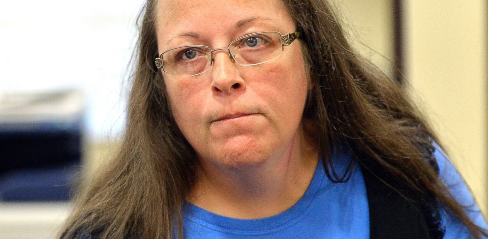 PHOTO: Rowan County Clerk Kim Davis listens to a customer following her offices refusal to issue marriage licenses at the Rowan County Courthouse in Morehead, Ky., Sept. 1, 2015.