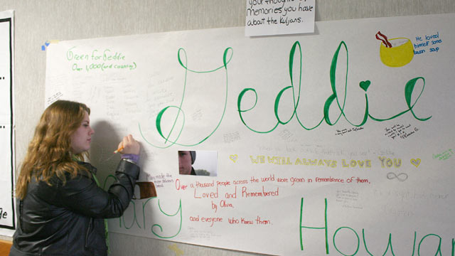 PHOTO: Arcata High School student Blaire Floyd writes on a poster memorial for fellow student Gregory Kulijan, Nov. 26, 2012, at Arcata High School in Arcata, Calif.