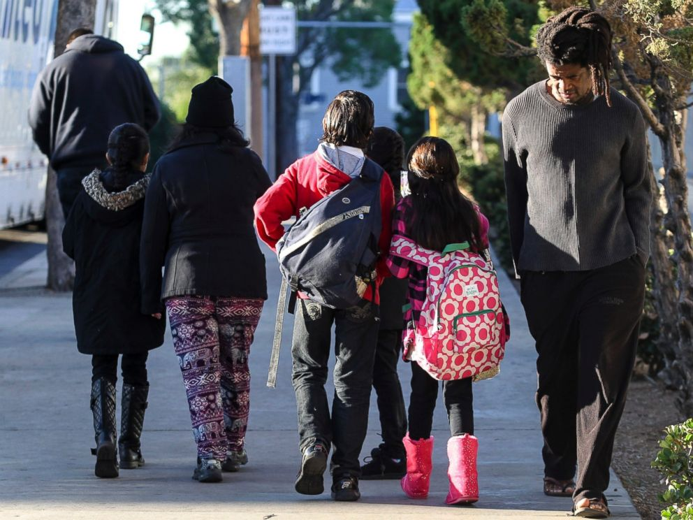 PHOTO: Parents take their children home from school early, Dec. 15, 2015, in Los Angeles.