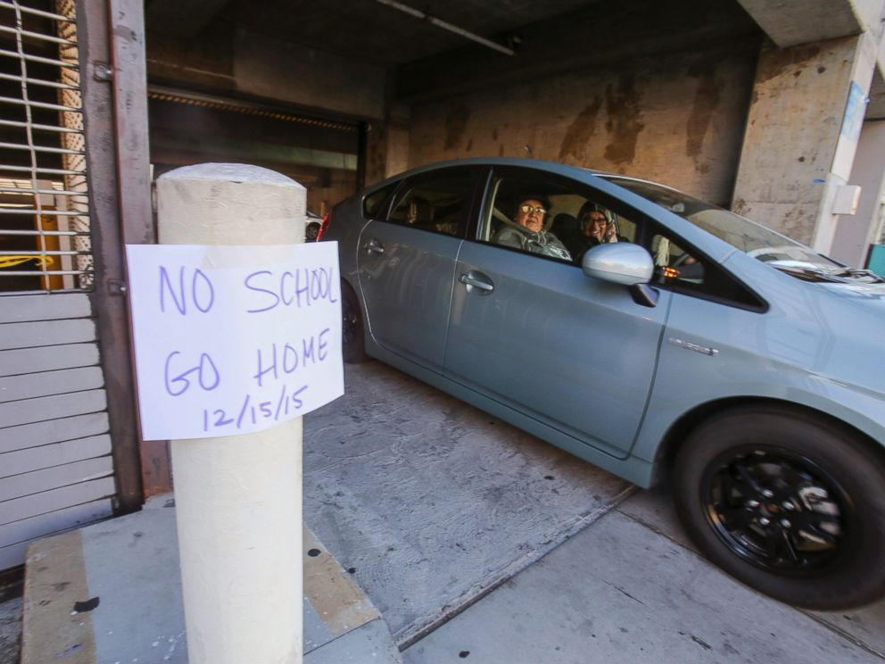 PHOTO: A vehicle leaves the Miguel Contreras Learning Complex past a sign that reads No School Go Home, Dec. 15, 2015, in Los Angeles.