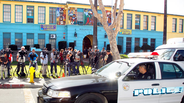 PHOTO: Members of the media gather outside the Miramonte Elementary school in Los Angeles, Calif., Feb. 3, 2012.
