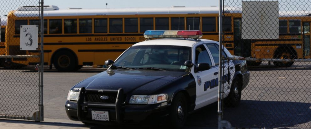 PHOTO: Los Angeles School District police patrols the districts bus garage in Gardena, Calif., Dec. 15, 2015.