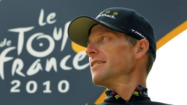 PHOTO:&nbsp; Lance Armstrong looks back on the podium after the 20th and last stage of the Tour de France cycling race in Paris, July 25, 2010.
