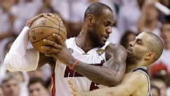 PHOTO: San Antonio Spurs guard Tony Parker (9) and Miami Heat forward LeBron James (6) collide during the second half of Game 6 of their NBA Finals basketball series, June 18, 2013 in Miami.