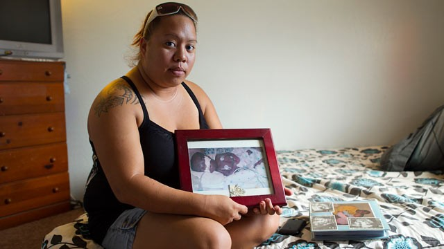 PHOTO: Leimomi Kahele holds a picture of her son Horace, who was born 15 weeks premature in 2004 and died shortly afterward,in Waialua, Hawaii.  A ceramic urn holding Horace's ashes was among the items stolen Wednesday during a burglary of the Kahele's ho