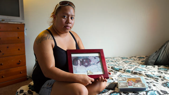PHOTO: Leimomi Kahele holds a picture of her son Horace, who was born 15 weeks premature in 2004 and died shortly afterward,in Waialua, Hawaii. A ceramic urn holding Horaces ashes was among the items stolen Wednesday during a burglary of the Kaheles ho