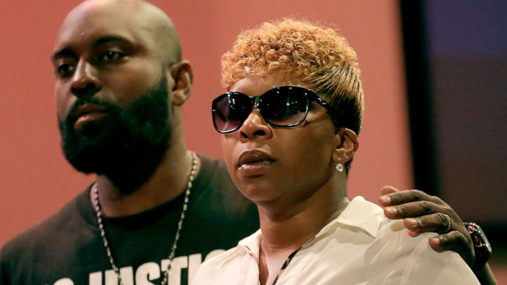 PHOTO: Michael Brown Sr. and Lesley McSpadden listen to a speaker during a rally on Aug. 17, 2014, for their son who was killed by police last Saturday in Ferguson, Mo.