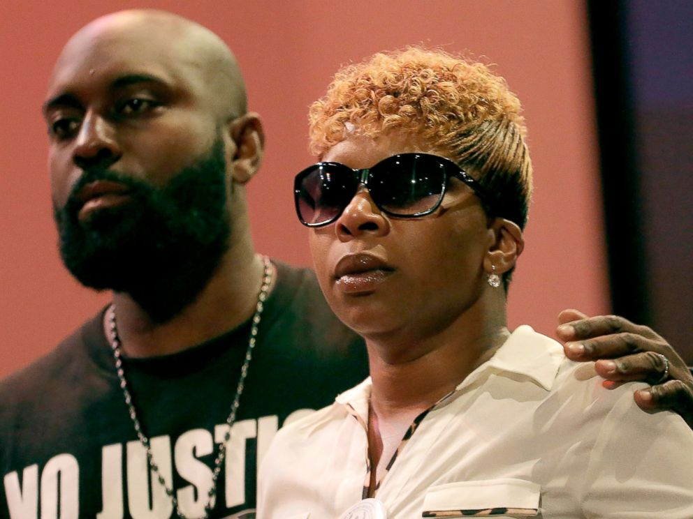 PHOTO: Michael Brown Sr. and Lesley McSpadden listen to a speaker during a rally, Aug. 17, 2014, for their son who was killed by police last Saturday in Ferguson, Mo.