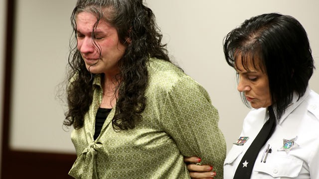 PHOTO: Defendant Dorice Moore, left cries as she is led out of the courtroom for a lunch break  after listening to a secret audio recording made by informant Greg Smith during Moore's murder trial on Dec. 4, 2012 in Tampa, Fla.
