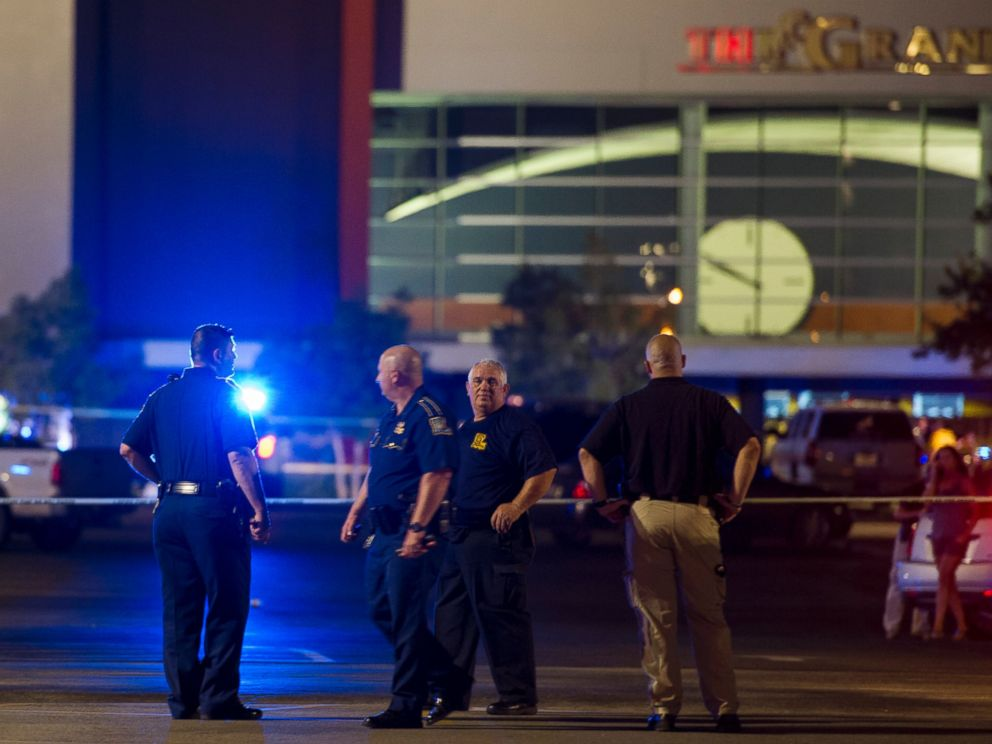 PHOTO: Law enforcement personnel stand near a police line at The Grand Theatre following a deadly shooting in Lafayette, La., July 23, 2015.