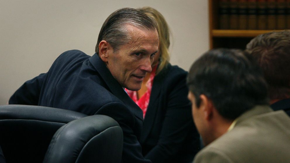 PHOTO: Martin MacNeill greets his defense team as he enters the courtroom after the jury reached a verdict. McNeill was found guilty of murder and obstruction of justice early Saturday morning, Nov. 9, 2013.