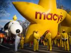 PHOTO: Balloon handlers wait before the 87th Annual Macys Thanksgiving Day Parade on Nov. 28, 2013, in New York.