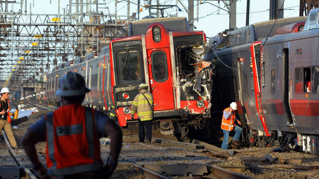 PHOTO: Emergency personnel work at the scene where two Metro North commuter trains collided, Friday, May 17