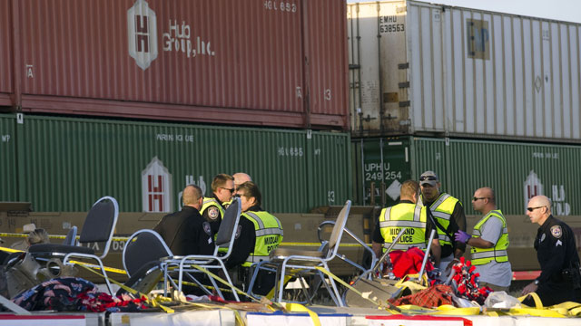 PHOTO: Midland police, fire and sheriffs respond to an accident where a trailer carrying veterans in a parade was struck by a train crossing in Midland, Texas, Thursday, Nov. 15, 2012.