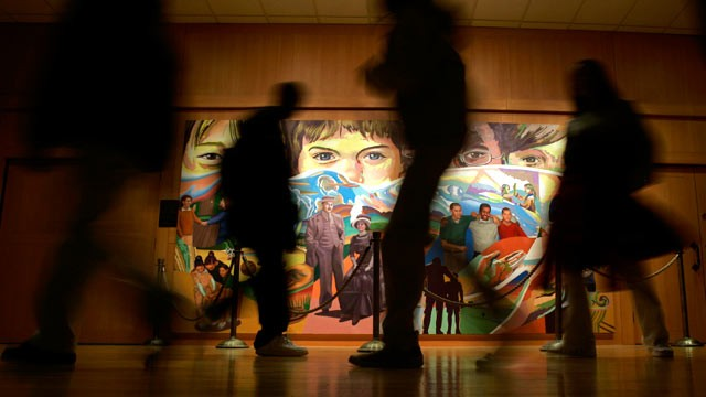 PHOTO: Students walk past &quot;The Apotheosis of Youth,&quot; a mural by Eliseo Art Silva at the Milton Hershey School in Hershey, Pa.