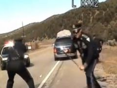 PHOTO: Three New Mexico State Police officers react as a minivan driven by motorist Oriana Farrell pulls away from a chaotic traffic stop.