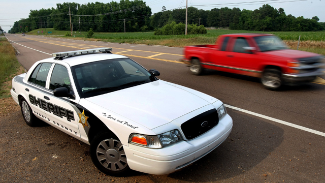 PHOTO: A DeSoto County Sheriff car patrols along Mississippi Highway 301, May 14, 2012, providing higher visibility following two recent roadway killings.