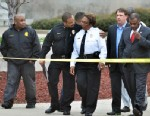 PHOTO: Jackson, Miss. Assistant Chief Lee Vance, center left, comforts Chief Rebecca Coleman, center right, April, 4, 2013, after detective Eric Smith was shot and killed inside the Jackson Police Department.