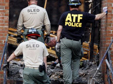 PHOTO: Investigators from the BATF and the South Carolina Law Enforcement Division sift through ashes and charred debris inside the Mount Zion African Methodist Episcopal church, July 1, 2015, in Greeleyville, S.C.