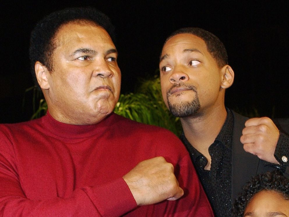PHOTO: Muhammad Ali and Will Smith pose at the premiere of the film Ali, in Los Angeles, Dec. 12, 2001.