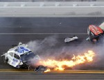 PHOTO: Kyle Larson, left, slides to a stop near Regan Smith (7) after a wreck at the conclusion of the NASCAR Nationwide Series auto race Saturday, Feb. 23, 2013, at Daytona International Speedway in Daytona Beach, Fla.