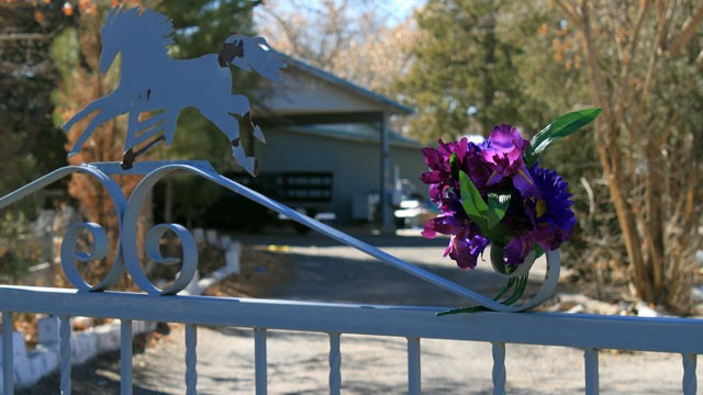 PHOTO: A bouquet of flowers adorns the entrance to a home on Jan. 21, 2013, where a couple and their three young children were found shot to death south of Albuquerque, N.M.