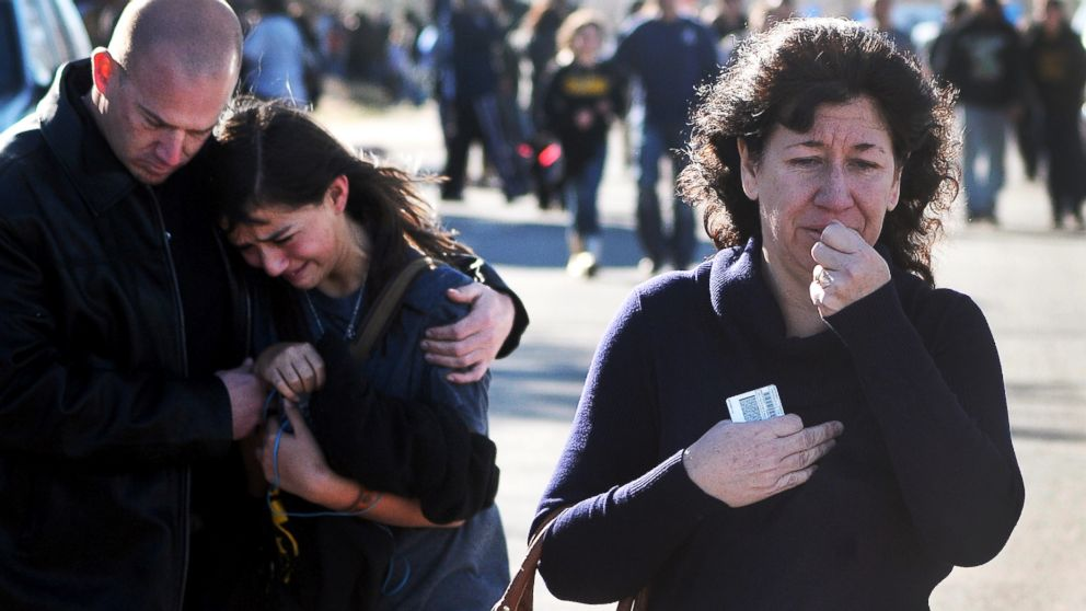 PHOTO: A woman waits at a staging ground area where families are being reunited with Berrendo Middle School students after a shooting at the school on Jan. 14, 2014, in Roswell, N.M.