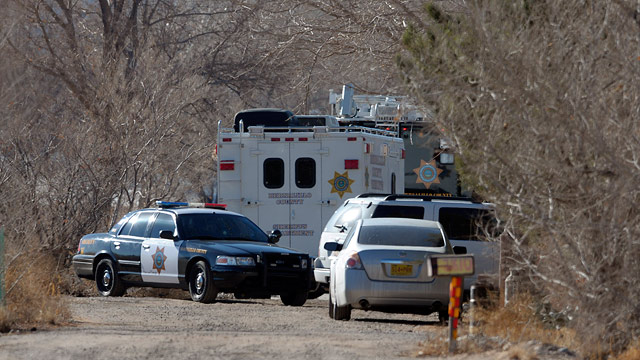 PHOTO: BCSO Deputies and crime scene personnel work the scene of a five person homicide in Albuquerque, NM, Sunday Jan. 20, 2013.