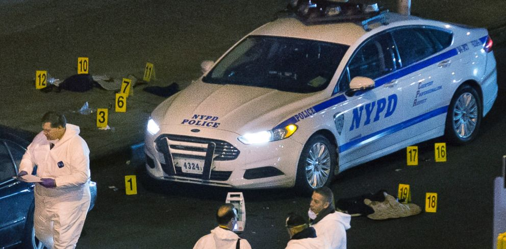 PHOTO: Bulletproof vests lie on each side of an NYPD patrol car as investigators work at the scene where two NYPD officers were shot in the Bedford-Stuyvesant neighborhood of the Brooklyn borough of New York on Saturday, Dec. 20, 2014.