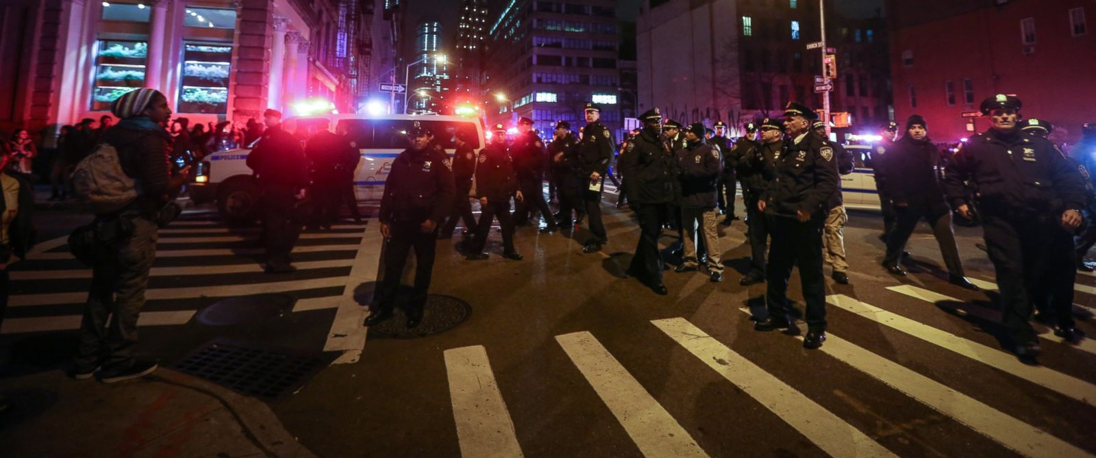 PHOTO: Police guard as hundreds of protesters gather at Foley Square in New York, Dec. 04, 2014.