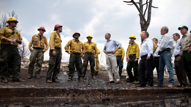 PHOTO: President Barack Obama talks with firefighters as he tours the Mountain Shadow neighborhood devastated by raging wildfires, June 29, 2012, near, Colorado Springs, Colo.
