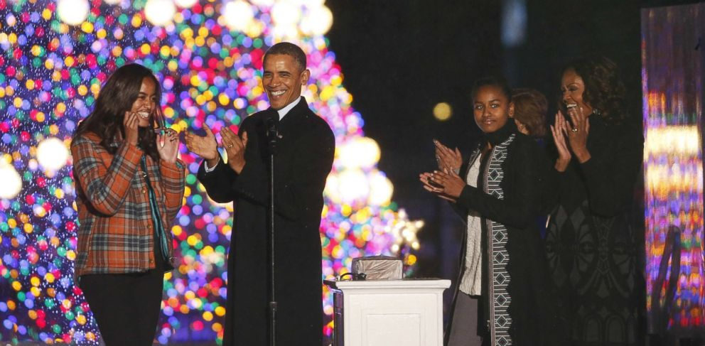 PHOTO: President Barack Obama, first lady Michelle Obama, daughters Sasha and Malia, applaud after lighting the National Christmas Tree at a ceremony across from the White House in Washington, Dec. 6, 2013.