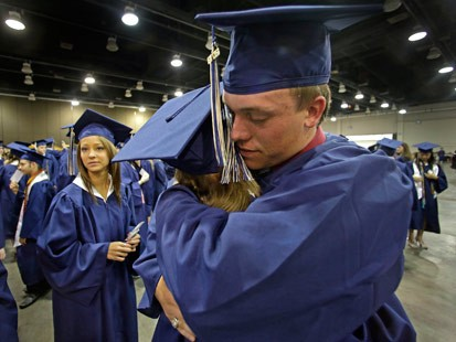 PHOTO: Southmoore High School senior Jake Spradling, hugs a classmate as they get ready to attend their commencement ceremony in Oklahoma City Saturday, May 25, 2013, five days after a tornado destroyed a large swath of their attendance area in Moore, Okl