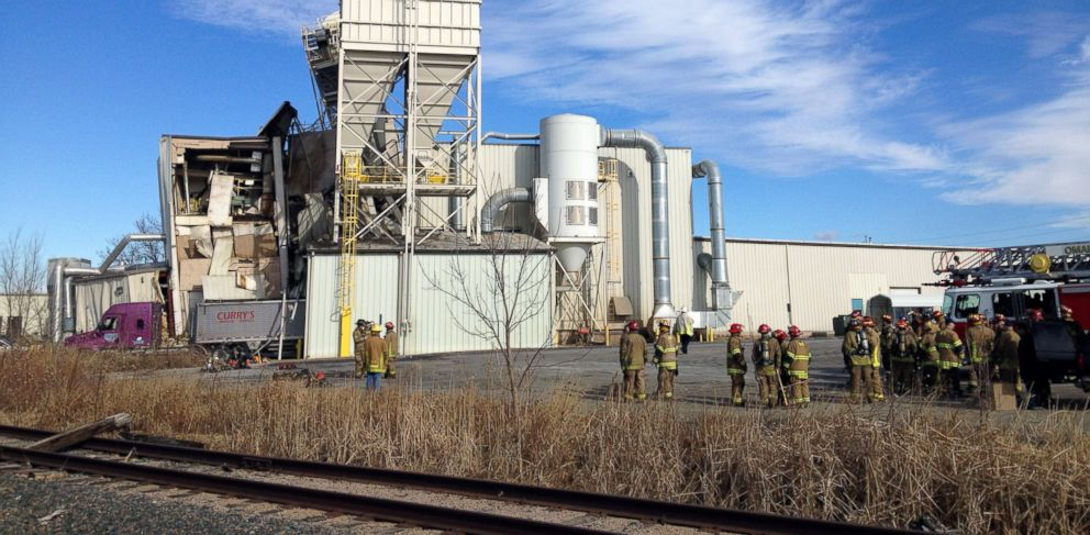 PHOTO: Firefighters stand outside the International Nutrition plant in Omaha, Neb. where a fire and explosion took place Jan. 20, 2014.